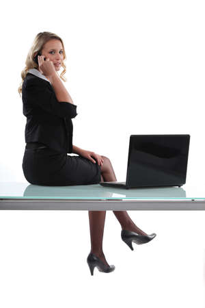 Woman sitting on her desk photo