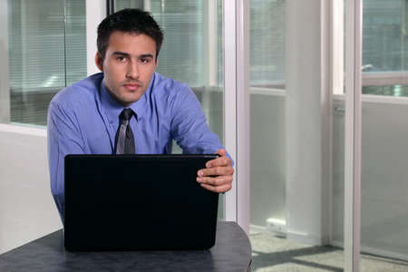 serious guy: Serious businessman with a laptop