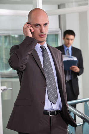 impassive: Businessman talking on his mobile phone Stock Photo