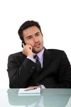 jaded: Businessman taking a phone call Stock Photo