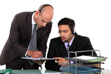 Office workers wearing headsets photo