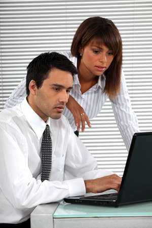 businessmeeting: co-workers in front of laptop Stock Photo