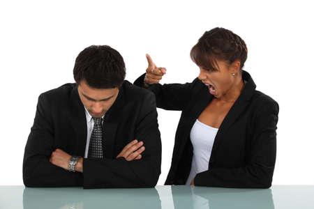 strict: Woman reprimanding her employee Stock Photo