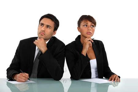 Pensive business couple photo