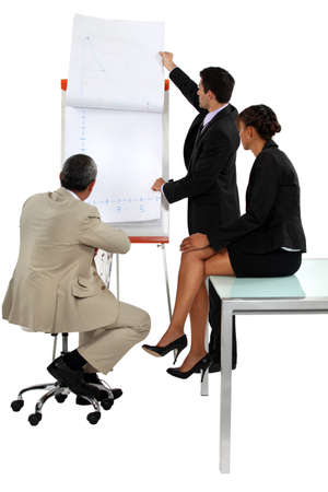 turning table: Businessman giving a presentation Stock Photo