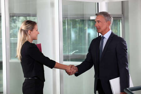 first job: A business handshake Stock Photo