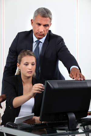 Personal assistant asking her boss a question photo