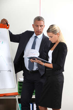 qualitative: A team of business professionals reviewing their data before a presentation