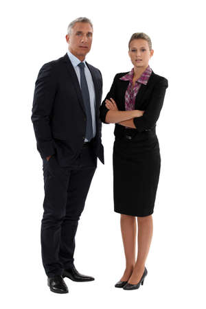 work wear: senior businessman and young businesswoman posing Stock Photo
