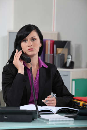 Receptionist writing note for boss Stock Photo - 17976666