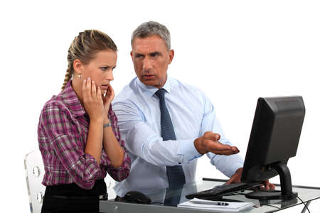 upset man: Employee having trouble with computer