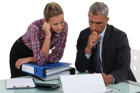 Boss explaining point to colleague Stock Photo - 18100090
