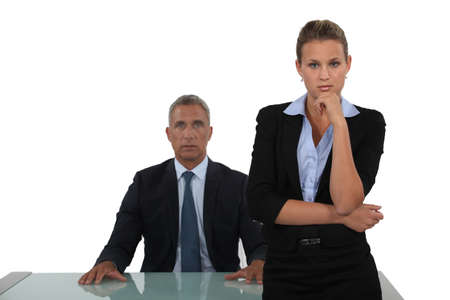 interested: Dynamic business duo Stock Photo