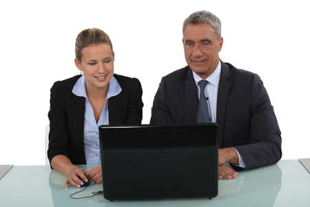 personal assistant: Business professionals watching a slide show