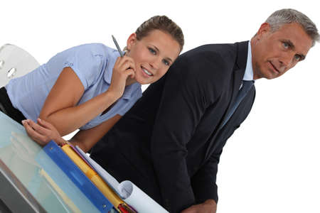 Boss sat with female assistant Stock Photo - 18099988