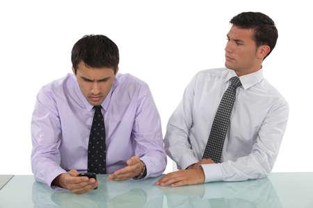life partner: Expressive businessmen sitting at a desk