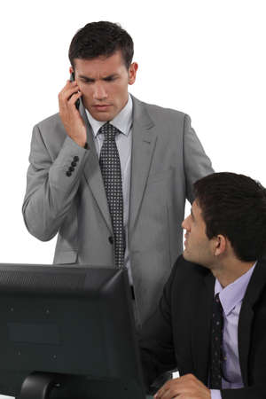 Businessman taking a troubling phonecall Stock Photo - 18100192