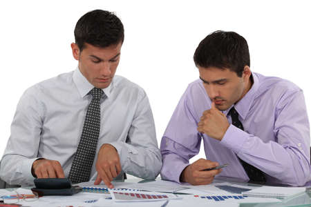 business risk: Businessmen with a calculator Stock Photo