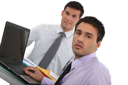 Young executives with a laptop