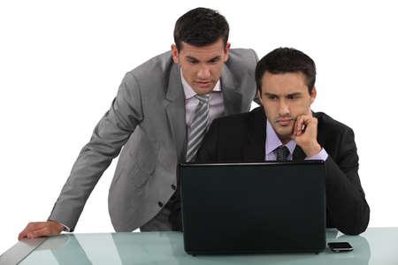 distressing: Business associates reading a distressing e-mail Stock Photo