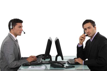 inquiries: Customer service representatives Stock Photo
