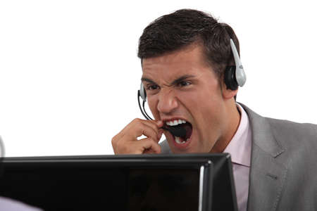 Male call-center working shouting at customer photo