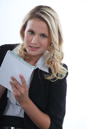 Blond receptionist taking notes photo