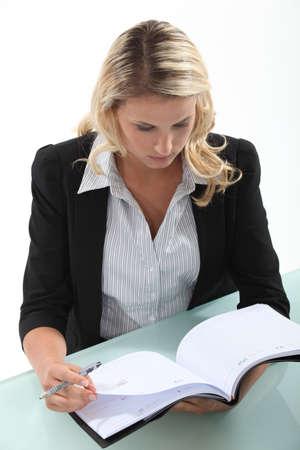 Secretary leafing through an agenda Stock Photo - 18099971