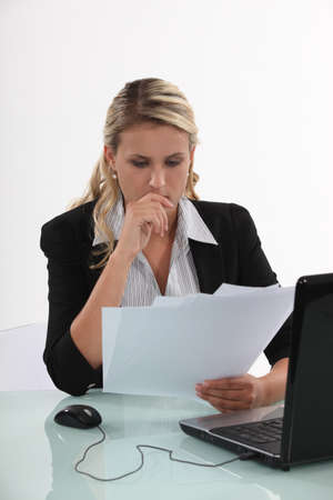woman with document: Businesswoman reviewing paperwork Stock Photo