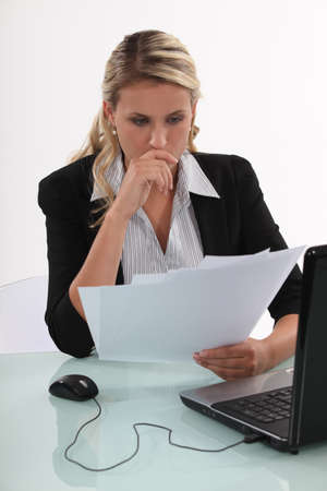 ordinary woman: Businesswoman reading a document Stock Photo