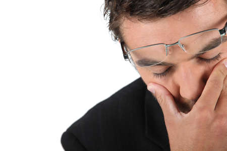 adult crying: Man in glasses expressing dread Stock Photo