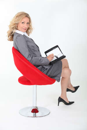 crossed legs: businesswoman on a chair