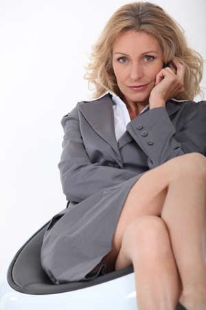 crossed legs: businesswoman on chair Stock Photo