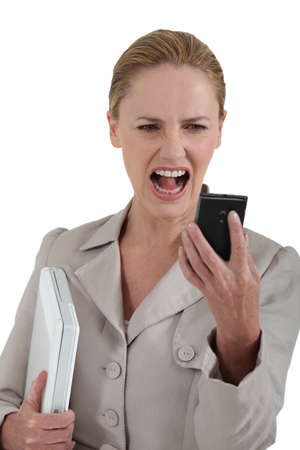 enquire: woman looking at her cell phone and screaming
