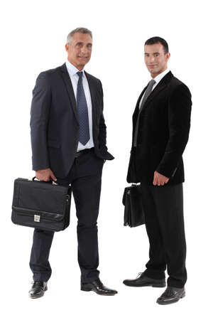 Two businessmen with briefcase photo