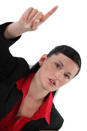 Businesswoman raising her hand Stock Photo - 18089193