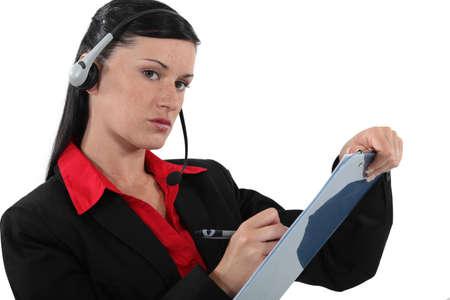 serious businesswoman taking notes photo