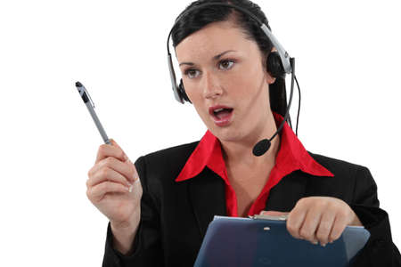 Woman with a headset and clipboard Stock Photo - 18088832