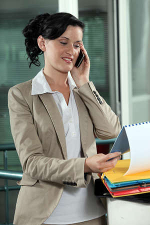 Business-worker looking at document during call Stock Photo - 18100200