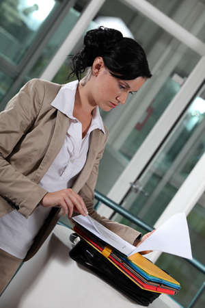 copy machine: young businesswoman looking at her documents Stock Photo