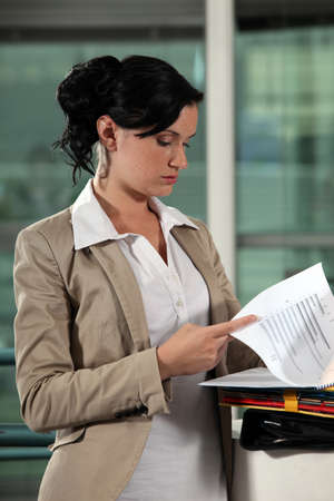 Woman looking documents photo