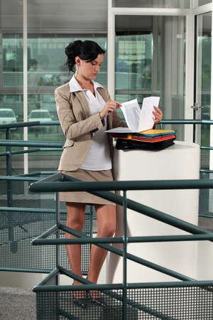 Businesswoman reading documents photo