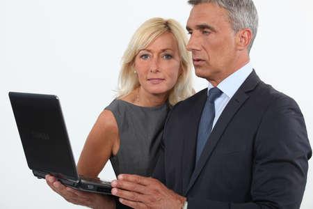affiliation: mature business couple posing