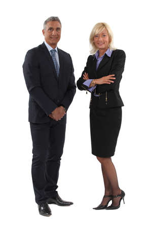 business woman standing: Full length business couple Stock Photo