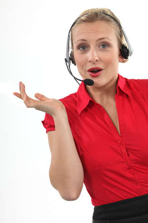 chirpy: Chirpy blond call-center worker Stock Photo