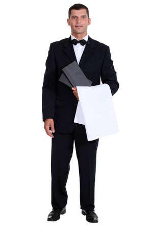 usher: Male waiter stood holding menu Stock Photo
