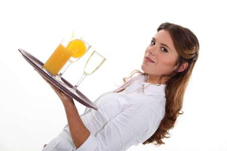 alcohol server: Waitress serving drinks