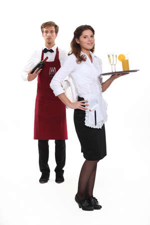 Waiter and waitress starting shift photo