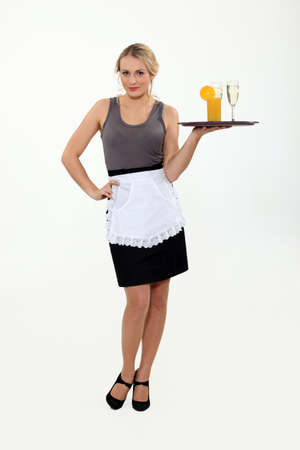 Waitress bringing drinks on a tray. photo
