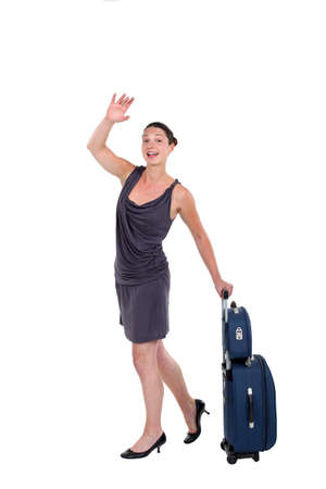 hailing: Woman with luggage hailing a taxi